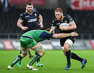 Ospreys' Dan Baker is tackled by Connacht's Sean O'Brien.<br /> <br /> Guinness Pro12 rugby match, Ospreys v Connacht rugby at the Liberty Stadium in Swansea, South Wales on Saturday 7th January 2017.<br /> pic by Craig Thomas, Andrew Orchard sports photography.