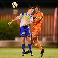 BRISBANE, AUSTRALIA - JANUARY 27: Ryan Palmer of the Strikers and Matija Simic of Lions compete for a headed ball during the Kappa Silver Boot Grand Final match between Lions FC and Brisbane Strikers on January 27, 2018 in Brisbane, Australia. (Photo by Patrick Kearney)