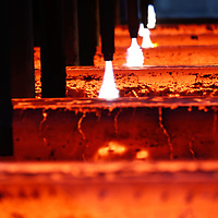 Hot steel bars in production in industrial steel plant