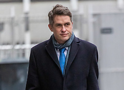 """© Licensed to London News Pictures. 25/02/2021. London, UK. Education Secretary Gavin Williamson arrives at his office in Westminster, London this morning as he makes plans for school's A Levels and GCSE exams to be voluntarily and give teachers control over grades as the government orders all schools back by 8th March 2021. This week, Prime Minister Boris Jonson announced his """"Roadmap Map' out of Lockdown with a gradual easing of Covid-19 restrictions with shops, pubs and gyms to open by April, Rule of Six and schools back by March and nightlife back by June. Photo credit: Alex Lentati/LNP"""