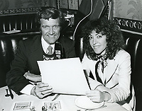 1978 Radio commentator/interviewer, Gregg Hunter is seen interviewing June Gable during his KIEV radio show at the Hollywood Brown Derby Restaurant, on Vine St.