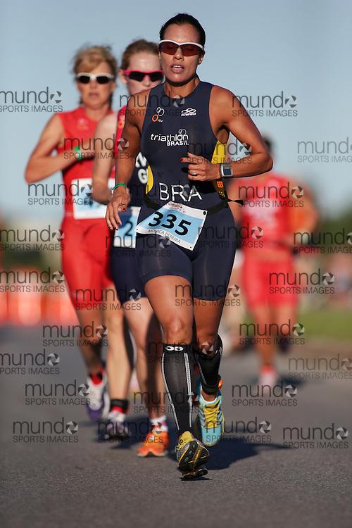 (Ottawa, Canada---10 August 2013)  Monica Pereira (335)  of Brazi (BRA) competing in the 40-44 Female AG International Triathlon Union 2013 World Duathlon Championships (10 km run- 40 km bike- 5km run).