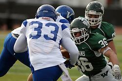 15 November 2014:  Luke Roth prepares to grab Filo Langkilde during an NCAA division 3 football game between the North Park Vikingsand the Illinois Wesleyan Titans in Tucci Stadium on Wilder Field, Bloomington IL