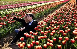 Italy, Arese - March 26, 2019.Friends take a selfie in a tulip field (Credit Image: © Piaggesi/Fotogramma/Ropi via ZUMA Press)