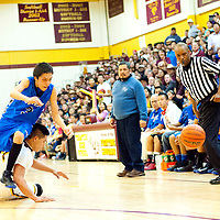 022813  Adron Gardner/Independent<br /> <br /> Navajo Pine Warrior Shad Etsitty (3) collides with Tohatchi Cougar Kevin Wylie (32) as Referee Judge Jackson, right, follows the ball out of bounds in Tohatchi Thursday.