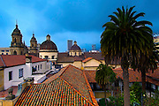 The towers of the Cathedral Primada and the Cupola of the Capilla del Sagrario sit within the Episcopal Pastoral Area of the Plaza Bolivar in Bogota, Colombia.