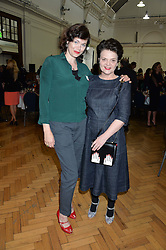 Left to right, JASMINE GUINNESS and LULU GUINNESS at a lunch in aid of the charity African Solutions to African Problems (ASAP) held at the Royal Horticultural Hall, Vincent Square, London on 19th May 2016.