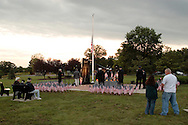 Washingtonville, N.Y. - People gather at the Washingtonville 5 Firefighters World Trade Center Memorial before a candlelight service on Sept. 11, 2008. The Memorial was built in honor of five FDNY firefighters from Washingtonville and the many others who lost their lives on September 11, 2001 in the World Trade Center terrorist attack.