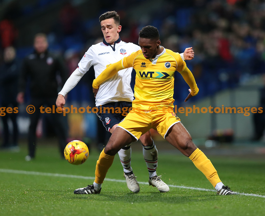 Bolton Wanderers striker Zach Clough (10) and Millwall defender Mahlon Romeo (12) vie for the ball during the Sky Bet League 1 match between Bolton Wanderers and Millwall at the Macron Stadium in Bolton. November 19, 2016.<br /> Nigel Pitts-Drake / Telephoto Images<br /> +44 7967 642437