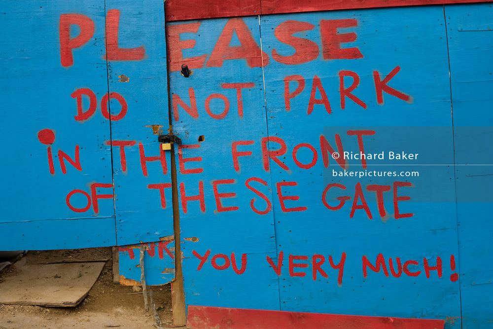 A notice not to park in front of a construction site, has been painted on to gates in South London.