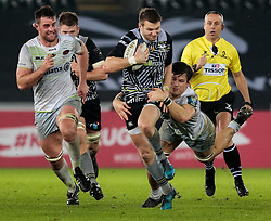 Ospreys' Dan Biggar is tackled by Saracens' Michael Rhodes<br /> <br /> Photographer Simon King/Replay Images<br /> <br /> European Rugby Champions Cup Round 5 - Ospreys v Saracens - Saturday 13th January 2018 - Liberty Stadium - Swansea<br /> <br /> World Copyright © Replay Images . All rights reserved. info@replayimages.co.uk - http://replayimages.co.uk