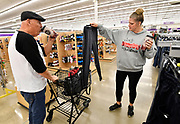 Don Gunter and his fiancee Michelle Kruse, both of Highland, inside the Gordman's store in Fairview Heights. They were looking for pants and boots for children, and were shopping for six. Shoppers looking for bargains and discounted items endured a light but steady rain on Thanksgiving Day as they waited for stores to open in Fairview Heights, IL on November 28, 2019.<br />  Photo by Tim Vizer