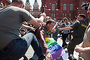 Moscow, Russia, 28/05/2011..Russian nationalists kick and punch a gay rights demonstrator holding a rainbow flag at an attempted gay pride parade in central Moscow. Several dozen people were arrested during clashes as Russian nationalists attacked gay rights activists during their sixth attempt to hold a gay pride parade in the Russian capital.