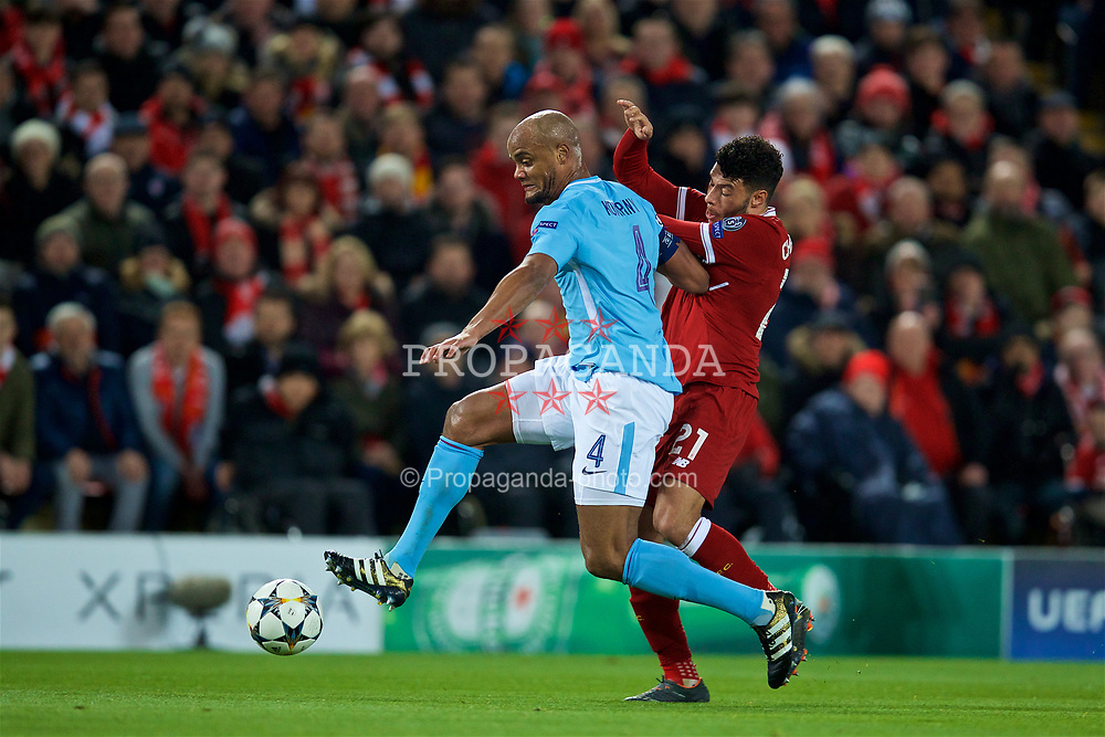 LIVERPOOL, ENGLAND - Wednesday, April 4, 2018: Manchester City's captain Vincent Kompany (left) and Liverpool's Alex Oxlade-Chamberlain during the UEFA Champions League Quarter-Final 1st Leg match between Liverpool FC and Manchester City FC at Anfield. (Pic by David Rawcliffe/Propaganda)
