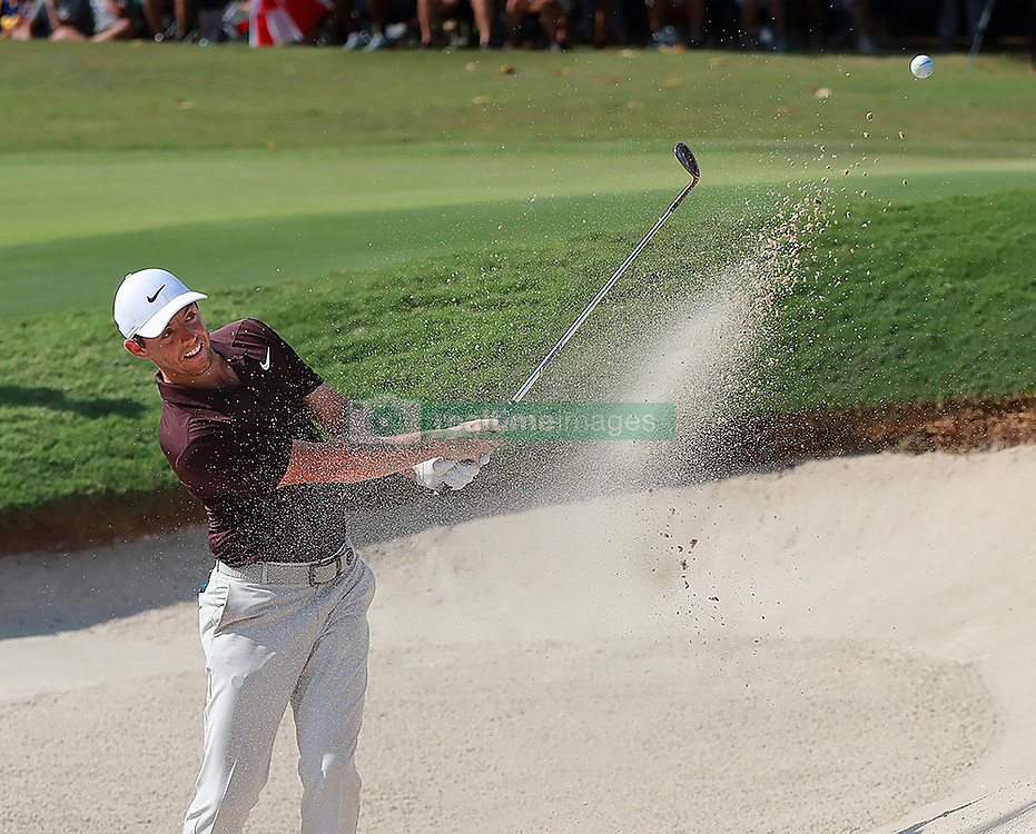 September 20, 2018 - Atlanta, GA, USA - Rory McIlroy hits from the bunker to the 18th green on his way to a birdie to finish 3-under par during the first round of the Tour Championship on Thursday, Sept. 20, 2018, in Atlanta, Ga. (Credit Image: © Curtis Compton/Atlanta Journal-Constitution/TNS via ZUMA Wire)