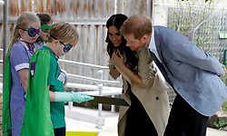 The Duke and Duchess of Sussex greet children during a visit to Albert Park Primary School in Melbourne, on the third day of the royal couple's visit to Australia.