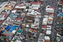 This handout photo by the Dutch Department of Defense shows an ariel view of Hurricane Irma damage on the Dutch Caribbean island of Sint Maarten (Saint Martin) on September 6, 2017. According to the latest information from NOAA's National Hurricane Center, the category 4 storm, has maximum sustained winds near 150 mph and is expected to make landfall on Florida on Sunday, September 10. Photo by Dutch Department of Defense/ABACAPRESS.COM