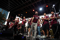 Oct 21, 2019; Sacramento, CA, USA; Players for the Sacramento Republic FC throw merchandise into the crowd during a fan celebration event for the new MLS soccer team at Capital Mall. Mandatory Credit: D. Ross Cameron-USA TODAY Sports