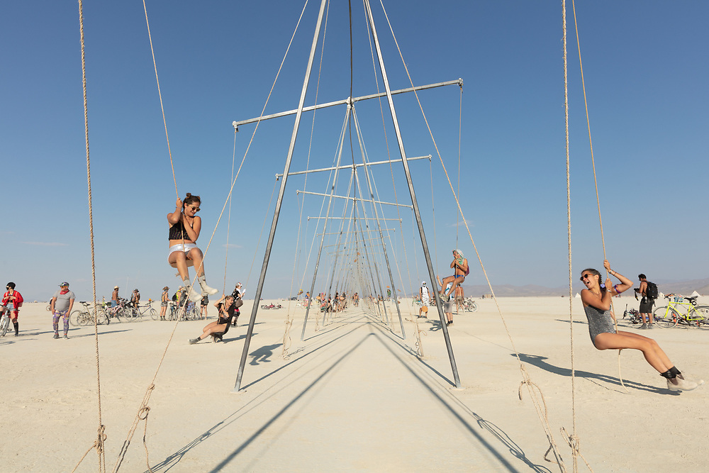 Burners playing on swings that are also seesaws. My Burning Man 2018 Photos:<br /> https://Duncan.co/Burning-Man-2018<br /> <br /> My Burning Man 2017 Photos:<br /> https://Duncan.co/Burning-Man-2017<br /> <br /> My Burning Man 2016 Photos:<br /> https://Duncan.co/Burning-Man-2016<br /> <br /> My Burning Man 2015 Photos:<br /> https://Duncan.co/Burning-Man-2015<br /> <br /> My Burning Man 2014 Photos:<br /> https://Duncan.co/Burning-Man-2014<br /> <br /> My Burning Man 2013 Photos:<br /> https://Duncan.co/Burning-Man-2013<br /> <br /> My Burning Man 2012 Photos:<br /> https://Duncan.co/Burning-Man-2012