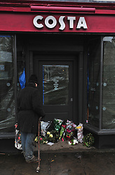 © Licensed to London News Pictures. 26/12/2015<br /> Flowers at the Costa coffee shop in Westerham in Kent. A 70 year old lady was killed here on Christmas eve after an Audi car crash into the shop.<br /> (Byline:Grant Falvey/LNP)