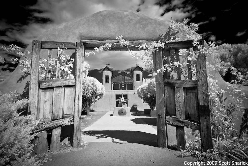 The open doors welcome you to the El Santuario de Chimayo, a shrine in the small town of Chimayo, New Mexico.