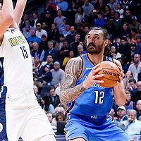 09 November 2017: Oklahoma City Thunder center Steven Adams (12) drives past Denver Nuggets center Nikola Jokic (15) during the Denver Nuggets 102-94 victory over the Oklahoma City Thunder, at the Pepsi Center, Denver, Colorado, USA.