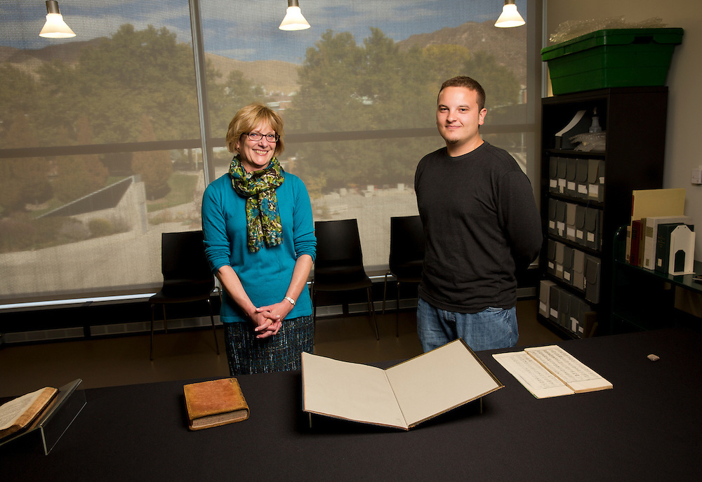 Luise Poulton, Rare Books Manager Special Collections and University of Utah student Matthew Scholl examine books in the rare book collection at the J. Willard Marriott Library on the campus of the University of Utah in Salt Lake City, Utah Wednesday Oct. 10, 2012. (Photo by August Miller).