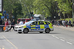 © Licensed to London News Pictures. 28/05/2021. London, UK. A police car at a crime scene on High Road, Wood Green, north London, following a death of a man. Police were called at just after 1am on Friday, 28 May to reports of a firearm discharge in the vicinity of Turnpike Lane. Police officers, the London Ambulance Service and London's Air Ambulance attended the scene. A man, believed to be aged in his 20s, was found suffering a gunshot injury. Despite the efforts of the emergency services he was pronounced dead at the scene at just before 2am. Photo credit: Dinendra Haria/LNP