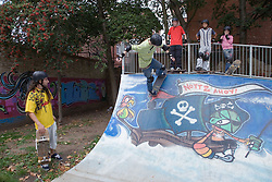 Teenagers at a skateboarding park,