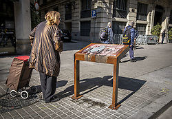 March 28, 2019 - Barcelona, Catalonia, Spain - A woman is looking at the damaged information point of the memory of Franco's repression..The information point that was placed a day ago in memory of the reprisals by the Franco regime that suffered torture in the former General Directorate of the Police was destroyed in its entirety last night by strangers. (Credit Image: © Paco Freire/SOPA Images via ZUMA Wire)