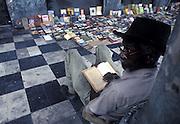 A street bookseller reading