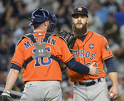 October 18, 2017 - Bronx, NY, USA - Houston Astros starting pitcher Dallas Keuchel (60) talks with catcher Brian McCann (16) during action against the New York Yankees in Game 5 of the American League Championship Series at Yankee Stadium in New York on Wednesday, Oct. 18, 2017. The Yankees won, 5-0, for a 3-2 series lead. (Credit Image: © Howard Simmons/TNS via ZUMA Wire)