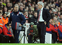 Football - 2016 / 2017 Premier League - Arsenal vs. Stoke City<br /> <br /> Stoke Manager Mark Hughes with assistant Mark Bowen at The Emirates.<br /> <br /> COLORSPORT/ANDREW COWIE