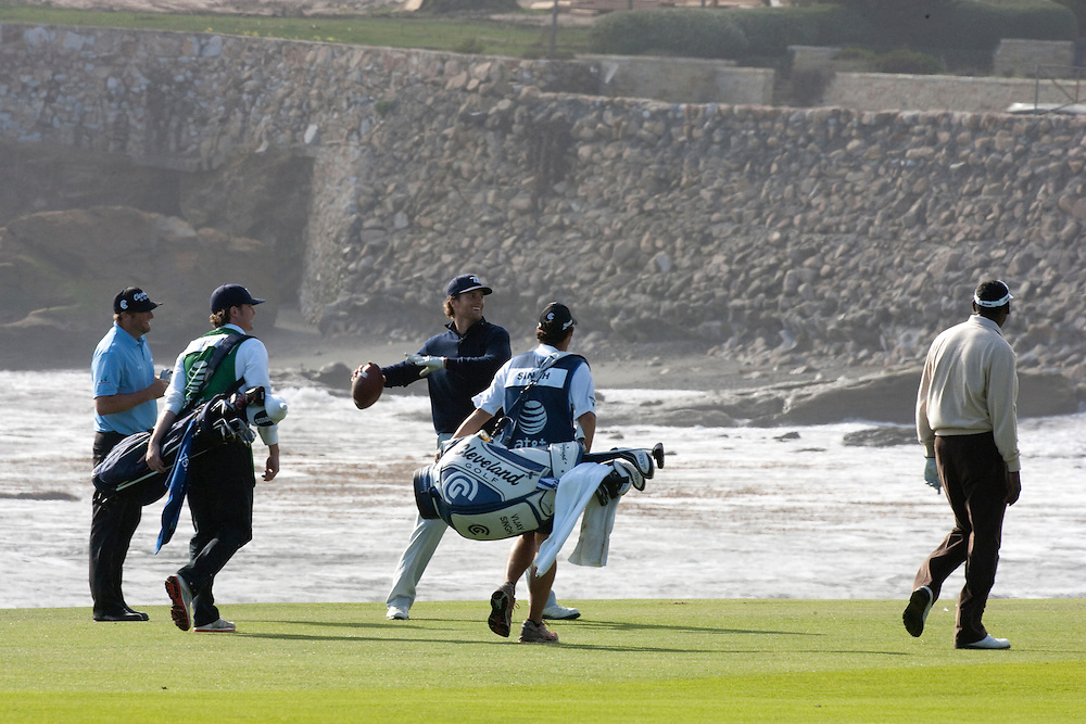 NFL Quarterback Tom Brady tosses football on final hole of the 2010 AT&T National Pro Am at Pebble Beach with Steve Marino and caddie.