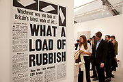 (Untitled) What a Load of Rubbish by Claire Fintaine. Visitors and exhibitors at the many galleries exhibiting at the Frieze Art Fair 2012. This art fair is for work at the high end of international contemporary art with many well known artists on show from many of the world's most reknowned dealers.