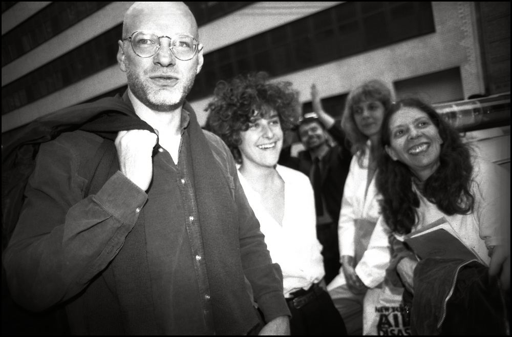 John Goodman, Zoe Leonard, Dr. Suzanne Phillips and Maxine Wolfe of ACT UP NY waiting for arrestees to be released after Target City Hall action in NYC on March 28, 1989.