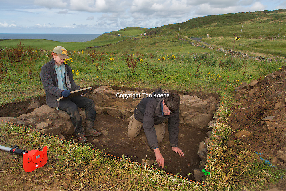 archaeologists working at dunluce castle