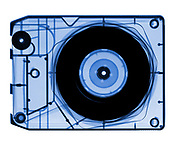 This is an X-Ray of an antique Eight Track Tape. The x-ray shows the internal structures that allow the tape to circulate in a loop that contains eight songs or tacks. This technology was popular in the early 1970's.