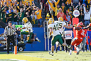 North Dakota State Bison running back Sam Ojuri (22) jumps into the end zone for a touchdown during the FCS title game against Sam Houston State at FC Dallas Stadium in Frisco, Texas, on January 5, 2013.  (Stan Olszewski/The Dallas Morning News)