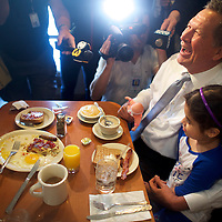 PHILADELPHIA, PA - April 25, 2016.  Repubican presidential hopeful John Kasich laughs while holding a girl's cool during a visit to the Penrose Diner in Philadelphia, PA on April 25, 2016.  In an effort to limit Donald Trump's delegate haul, last night the Ohio Governor announced a pact with Tex Sen. Ted Cruz agreeing to not campaign in Indiana, with Cruz not campaigning in Oregon and New Mexico.  The Pennsylvania Primary takes place tomorrow.  CREDIT: Mark Makela for The New York Times