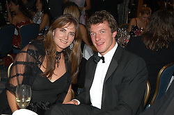 MISS MANDY TARRANT and Athens 2004 Olympic Gold Medal oarsman STEVE WILLIAMS at the Chain of Hope Autumn Ball Fiesta held at The Dorchester, Park Lane, London on 6th October 2004.