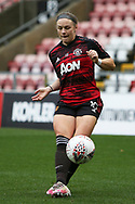 Portrait full length Manchester United midfielder Kirsty Hanson (18) warming up during the FA Women's Super League match between Manchester United Women and Manchester City Women at Leigh Sports Village, Leigh, United Kingdom on 14 November 2020.