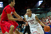DALLAS, TX - JANUARY 4: Shabazz Napier #13 of the Connecticut Huskies drives to the basket against the SMU Mustangs on January 4, 2014 at Moody Coliseum in Dallas, Texas.  (Photo by Cooper Neill) *** Local Caption *** Shabazz Napier