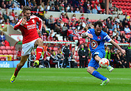Chris Dagnall attempts a shot during the Sky Bet League 1 match between Swindon Town and Leyton Orient at the County Ground, Swindon, England on 3 May 2015. Photo by Alan Franklin.
