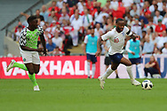 England Raheem Sterling (10) dribbling away from Nigeria Kenneth Omeruo (4) during the Friendly International match between England and Nigeria at Wembley Stadium, London, England on 2 June 2018. Picture by Matthew Redman.