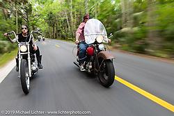 Kissa Von Adams on her custom chopper alongside Bill Grotto of Twisted Tea on his personal Panhead through Tomoka State Park during Daytona Bike Week. FL. USA. Sunday March 18, 2018. Photography ©2018 Michael Lichter.