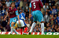 Photo: Alan Crowhurst.<br />Portsmouth v West Ham United. The Barclays Premiership. 14/10/2006. Andy Cole (C) turns away after scoring Pompey's second.