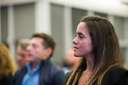 Carol Mello watches the panel discussion at the Silicon Valley Business Journal's Scale Up event at the Computer History Museum in Mountain View, California, on November 13, 2018. (Stan Olszewski for Silicon Valley Business Journal)