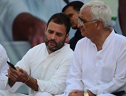 September 15, 2016 - Kaushambi, India - Indian Congress party's vice president and leader Rahul Gandhi talks with senior party leader Salman Khursheed (R) before  addressing a public meeting, popularly known as Khaat Panchayats, where organizers make arrangement of thousands of Khaats (cots) for the people attending the meetings to sit on them, while listening to their leader, in tenwa village , in Kaushambi on September 15, 2016.Khaat (rustic Hindi word for cot) is symbol of villages in general and of farmers in particular. By naming the public meetings as Khaat Panchayats arranging khaats during the meetings, a strategy has been drawn to connect Rahul and Congress with the farmers of Uttar Pradesh and thus reap the electoral harvests during the next assambly elections  (Credit Image: © Ritesh Shukla/NurPhoto via ZUMA Press)