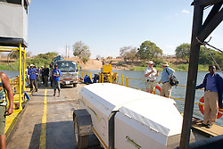 Crossing the River By Car Ferry